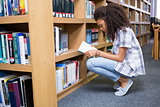 Student reading book in library