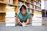 Student lying on library floor
