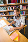 Student studying in the library with laptop