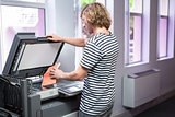 Student photocopying his book in the library