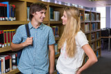 Students discussing in the library