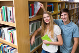 Students smiling at camera in the library