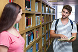 Students in the library smiling at each other