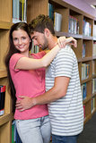 Cute couple embracing each other in the library