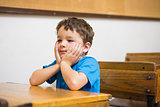 Focus pupil sitting at his desk