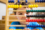 Student doing maths on abacus