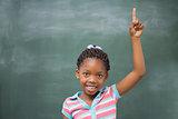 Pupils raising hand in classroom