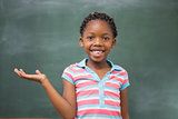Smiling pupil raising her hand