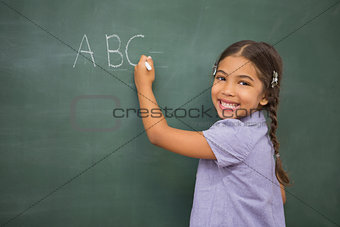Pupil writing on large blackboard