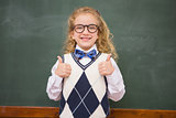 Happy pupil looking at camera with thumbs up
