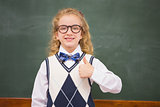 Happy pupil looking at camera with thumb up