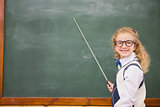 Happy pupil pointing the blackboard
