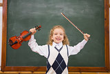 Cute pupil holding violin and violin string