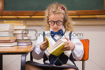 Blonde pupil reading a book