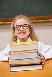 Smiling pupil holding books
