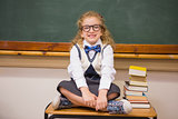 Cute pupil sitting on table