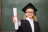 Pupil with graduation robe and holding her diploma