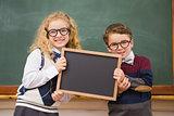 Pupils holding blackboard