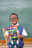 Smiling pupil holding abacus