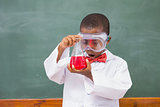 Surprise pupil looking at a red liquid