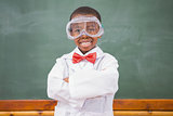Chemistry pupil smiling at camera with arms crossed