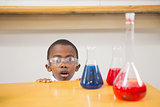 Shocked pupil looking at liquids