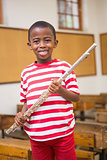 Happy pupil holding flute
