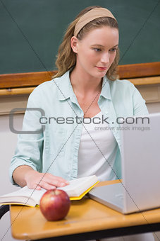 image 6378014 focus teacher at her desk from crestock