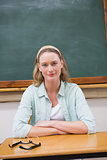 Teacher looking at camera with arms crossed