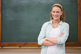 Teacher smiling at camera with arms crossed