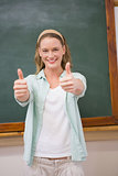 Teacher smiling at camera with thumbs up
