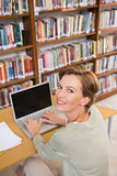 Focus teacher using laptop at library