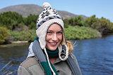Happy casual woman at a lake