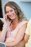 Happy mother on the phone
