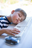 Little boy slipping on keyboard