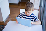 Little boy using tablet pc