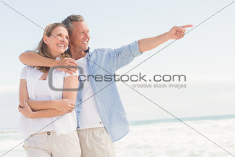 Happy couple looking to sea