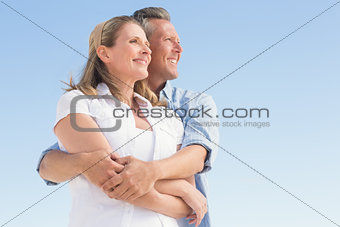 Happy couple standing and hugging
