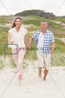 Casual couple walking holding hands