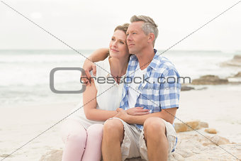 Casual couple sitting on rock