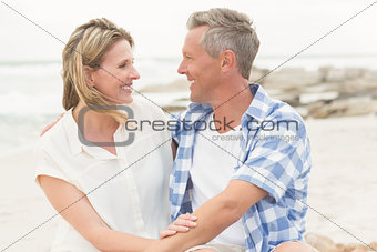 Casual couple smiling at each other