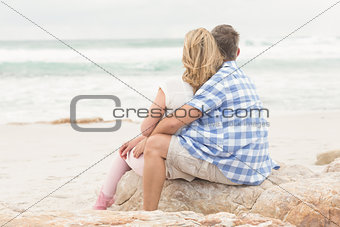 Casual couple looking to sea