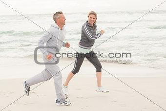 Fit couple jogging together