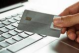 Man using laptop for online shopping