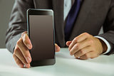 Businessman showing his smart phone