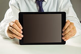 Businessman showing his tablet pc
