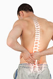 Highlighted spine of man with back pain