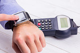Man using smart watch to express pay