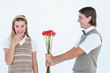 Geeky hipster offering red roses to his girlfriend