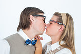 Geeky hipster couple kissing